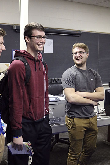 Underclassmen ask the current VEI students what it takes to be in the class. Seniors Phillip McKee and Dylan Crankshaw explain to the students that in order to take the class they had to of taken a business math class prior to entering. Crankshaw and McKee explain what their roles are in VEI.