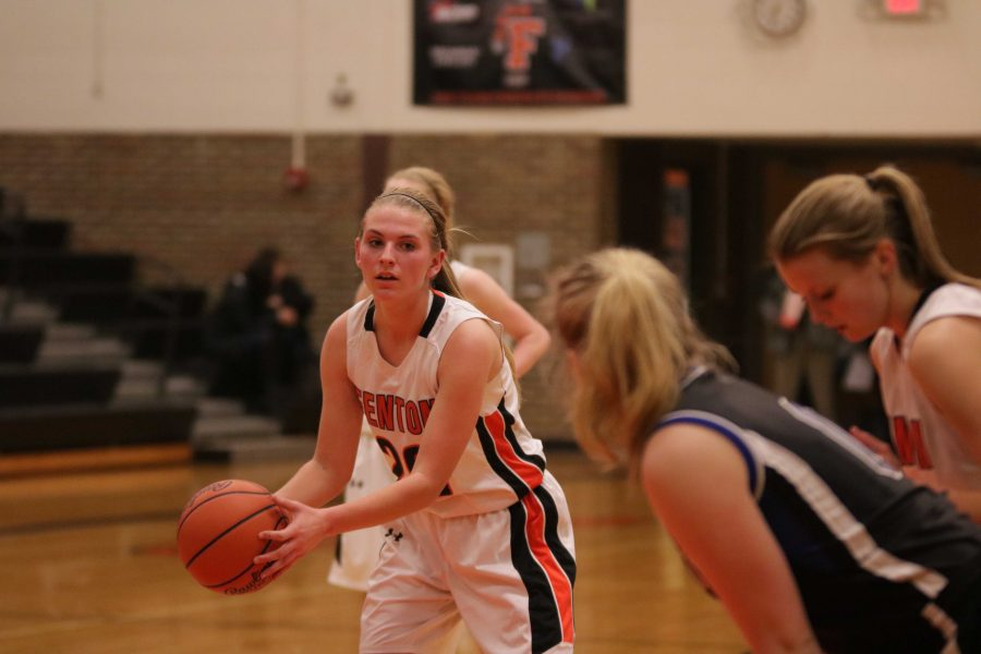 As she focuses up, sophomore Erin Carter, prepares to make her shot.