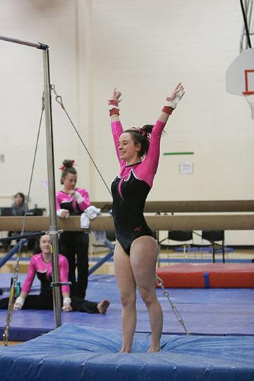 Carly Kozlowski at a gymnastics meet on Feb.2. Carly scored a 7.95 on bars.