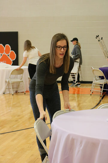 National Honors Society students helping set up for the annual daddy daughter dance. Senior Emma Evo volunteered her time on Feb. 4 to help get ready.