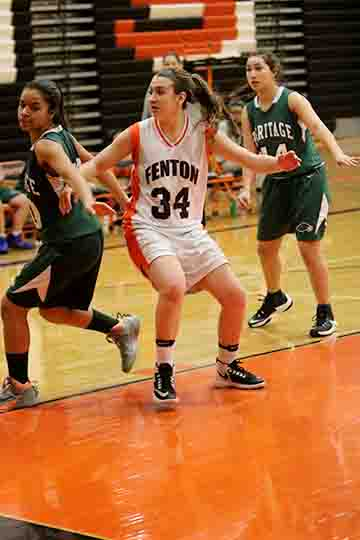 Lilly McKee blocking the freshman Heritage girls basketball team. Lilly scored 2 point and had 6 rebounds.