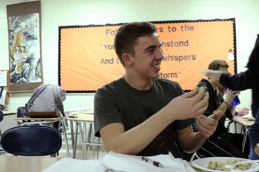 Sophomore Zach Pierson celebrates Mr. Mead's birthday by eating cookies that were made by one of his classmates. With a big smile on his face, he enjoyed his conversation with Zach Schulz.