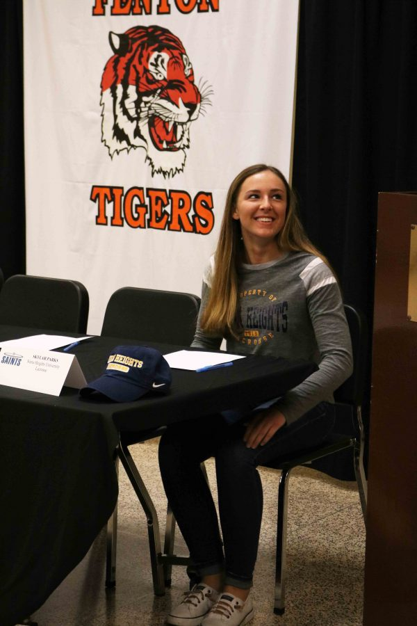 As she prepares to sign to Sienna Heights to play lacrosse next year, senior Skylar Parks waits to be joined by her peers. The high school had 14 athletes last week that signed to their college.