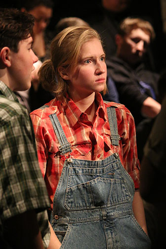 Acting as Scout in the IB theater's production of To Kill A Mockingbird, senior Jessica Sieradski listens to her father, Atticus, played by Frisco Alvarado.
