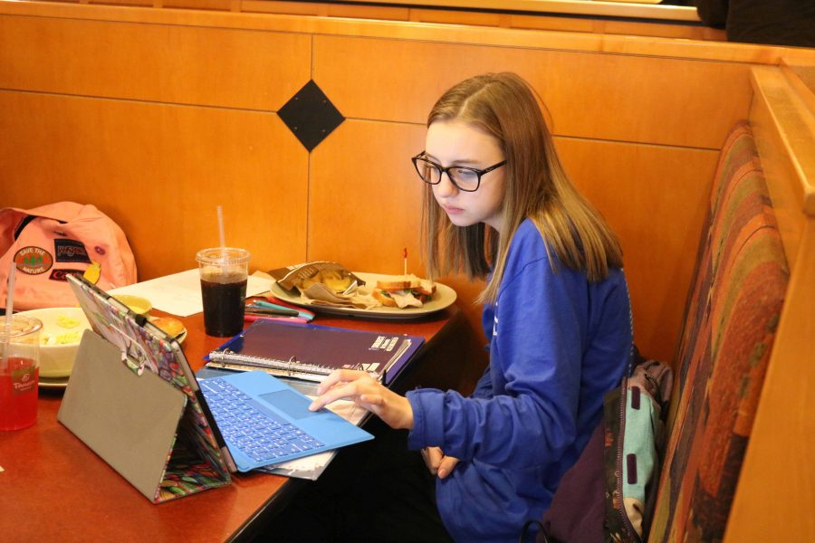 At the publications fundraiser in panera, junior Melissa Tousley studies for her mid terms.