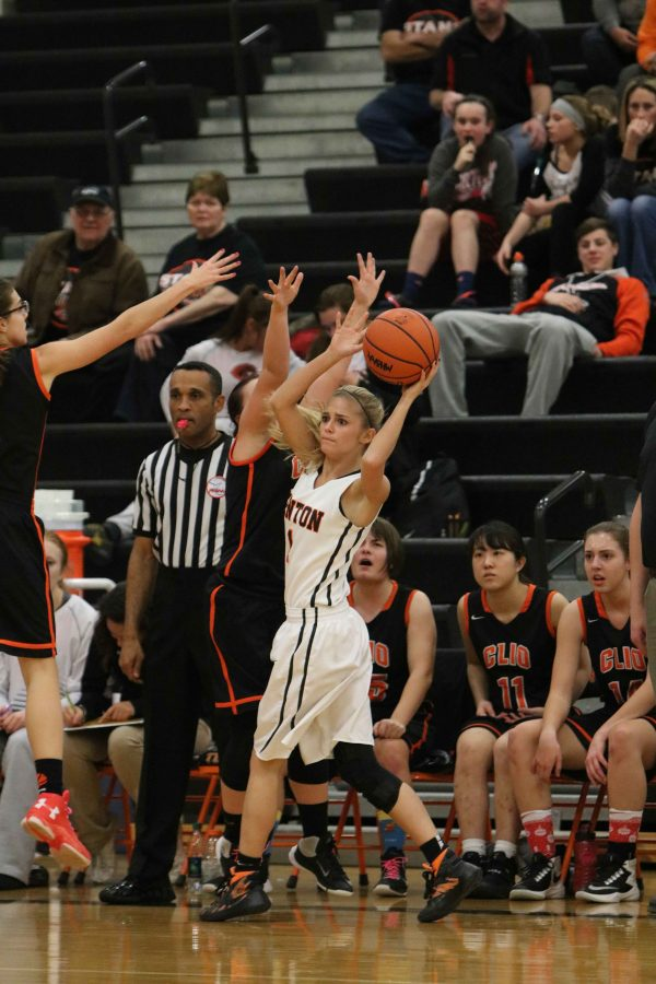 Competing in her basketball game against Clio, senior Kiley Aldred looks for someone to pass the ball to. The girls beat Clio 68-49.