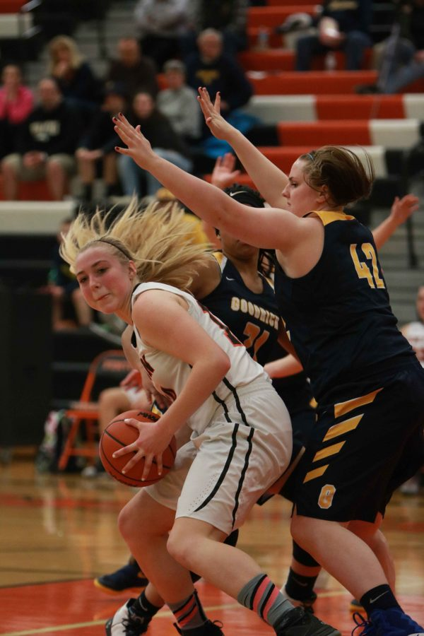 Playing in her last home game of the season, sophomore Chloe Idoni fights off the Goodrich players. The girls won the game 60-55.