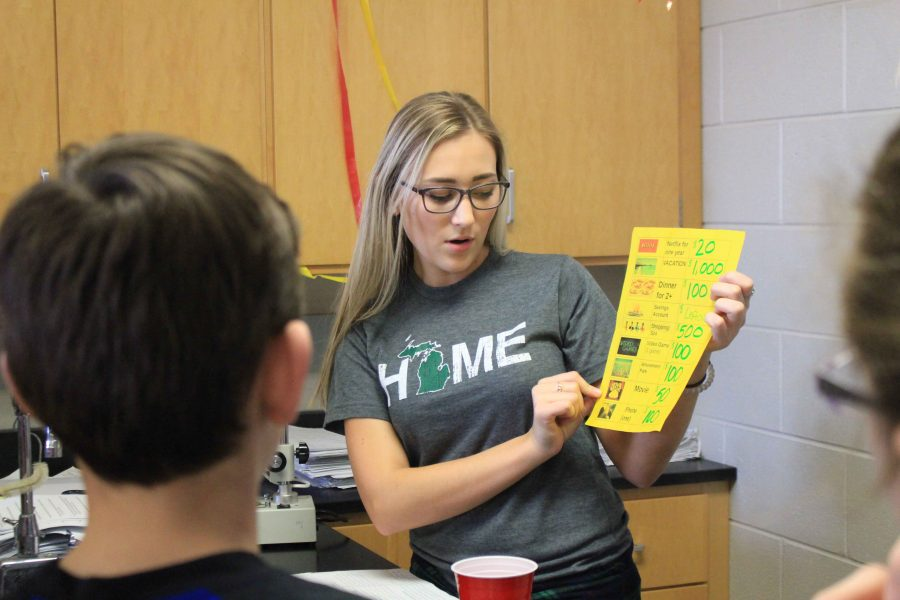 Presenting in front of AGS sixth graders senior Hailey Bates explains the purpose of this educational game. The Mentor Training program helps educate younger kids on the dangers of doing drugs and alcohol.