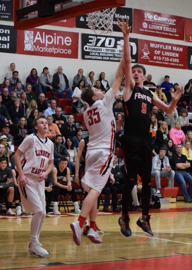 Senior Nick Wyrick goes up to make a shot during the last quarter, as a Linden player is ready to block him