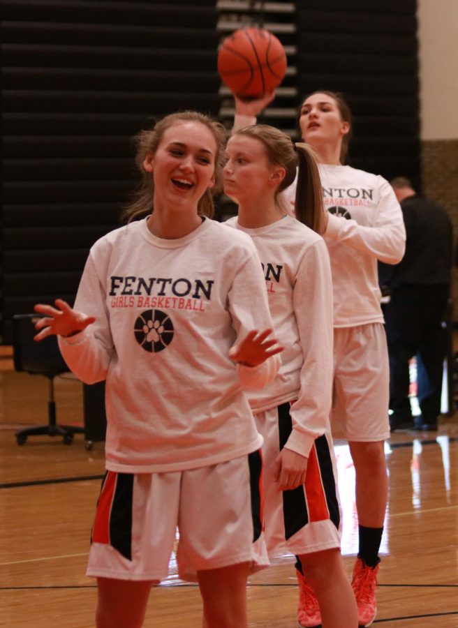 Sophomore Sarah Reuschlein jokes around with teammates while warming up before a game. The girls JV team played Flushing high school at Thursday's game on Feb. 2.