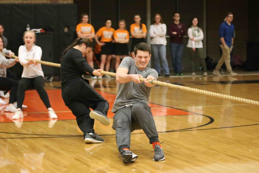 Competing in the Snowcoming pep assembly, junior Josh Czarnota takes part in the junior tug a war against the freshman. The staff ended up beating the juniors becoming the champions for tug of war.