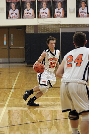 In the game against Linden, sophomore Logan Welch sprints down the court to pass to his teammate to shoot against Linden.