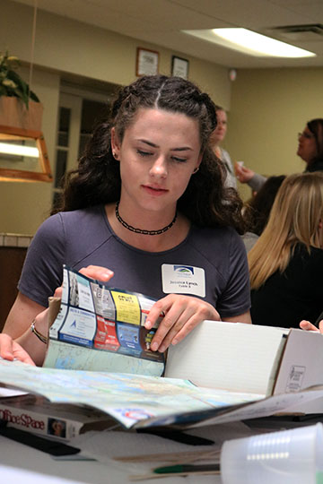 Each group of girls were provided with supplies they had to put together to make their business. Junior Jessica Lynch put the map on her group's business.