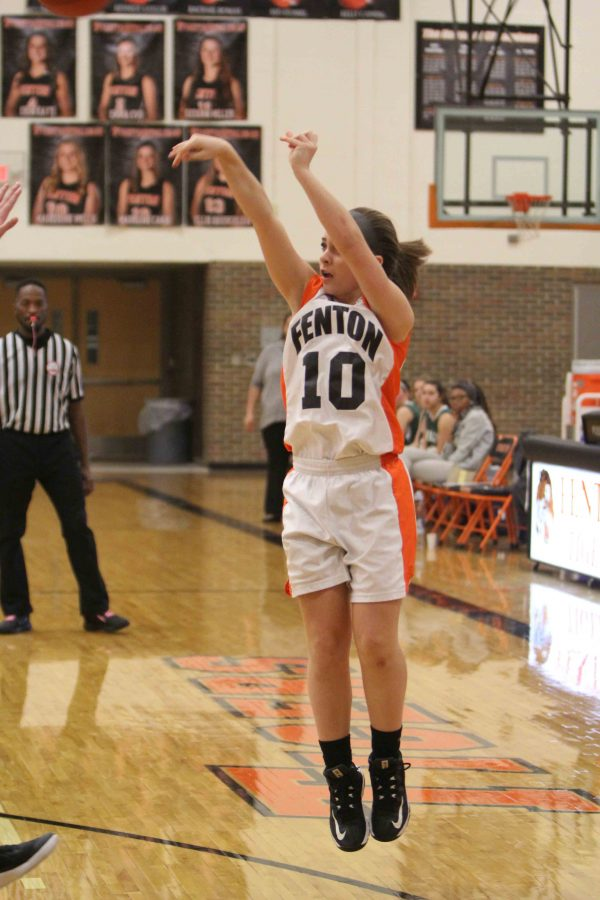 Freshman Maria Ebert shoots a three pointer during the last quarter against Goodrich High School.