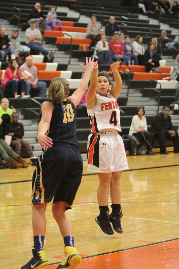 Kirstin Foor lines up her jump shot in one of her last games of her JV season against Goodrich High School.