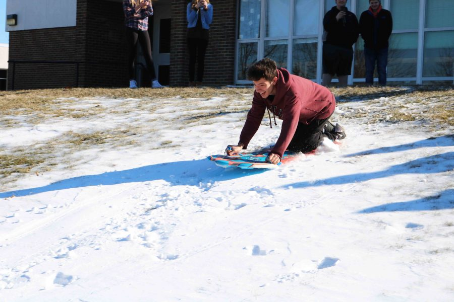 Going sledding for the first time ever, foreign exchange student Lucas Bartoleto experiences Michigan weather in all its snowy glory. This was his first winter and his forensic science teacher Matthew Sullivan wanted him to experience sledding before the snow melted.
