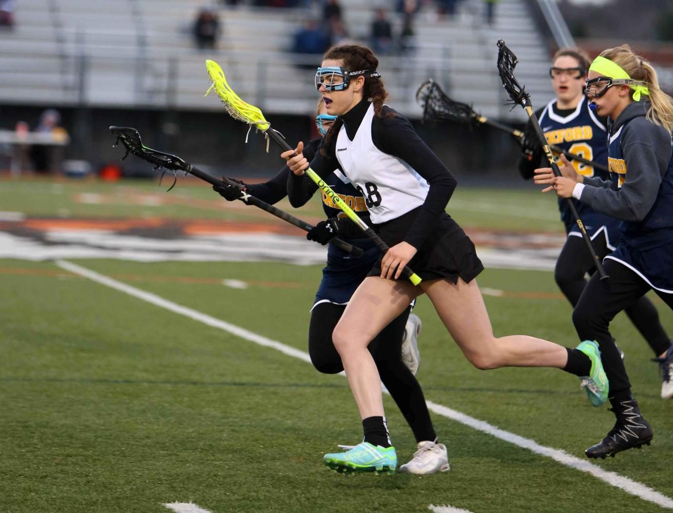 With her eyes on the net, junior Jessica Lynch sprints down the field ready to score during the varsity Lacrosse game against Oxford High School.