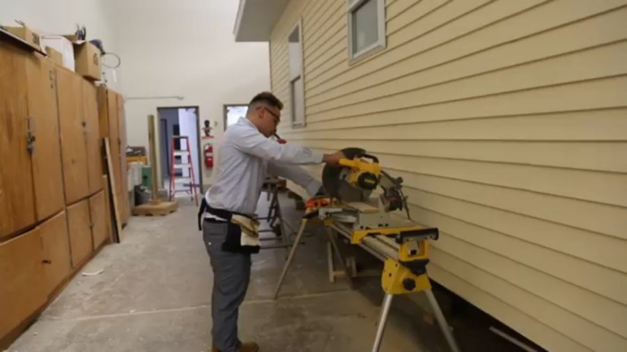 Senior Christian Herrera cuts wood with an electric saw in his construction class at GCI. Herrera is one of 1,300 students from 21 school districts in Genesee Career Institute. He is currently enrolled in the Career and Technical Education program.
