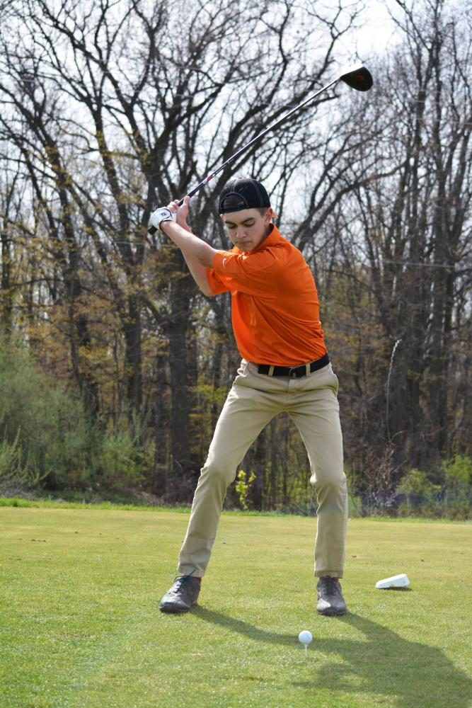 Playing in a practice game, junior Mitchell Chopp plays with the rest of his four man scramble team. At the sixth hole Chopp drives his ball down the course putting his ball in the pond at the bottom of the hill.
