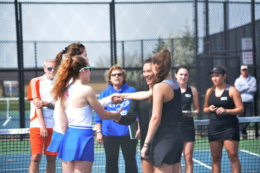 Before Tuesdays game, sophomore Leah Brackenridge shakes hands with her opponents for that days match. Leah participates in the doubles match along with her partner junior Catherine Maxwell on the Fenton varsity tennis team.