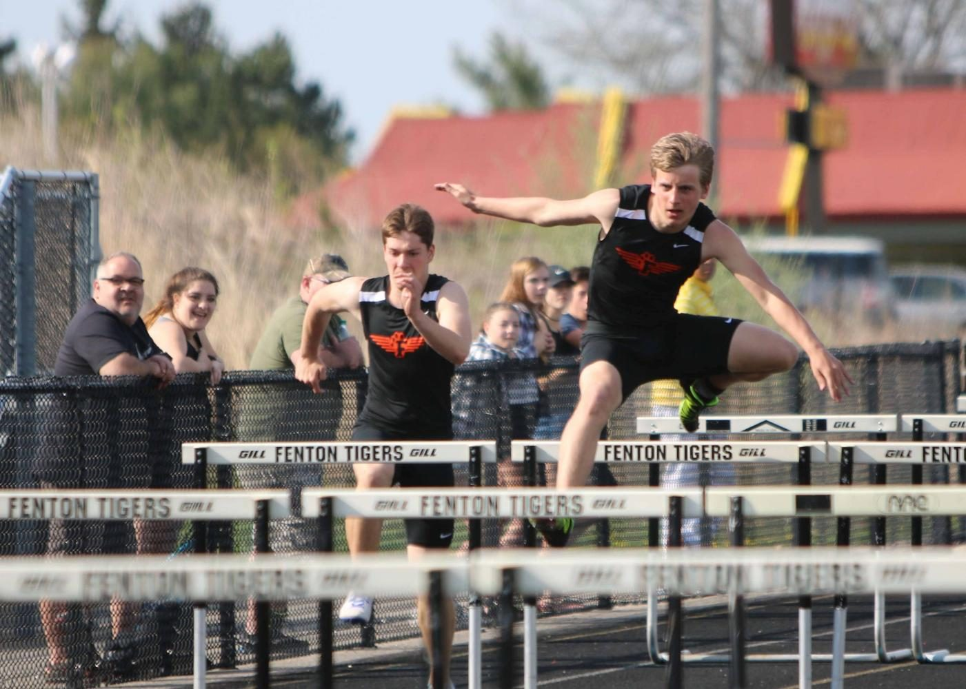 Running the hurdles, sophomore Nick Accopiate pushes himself to do his best in the event.