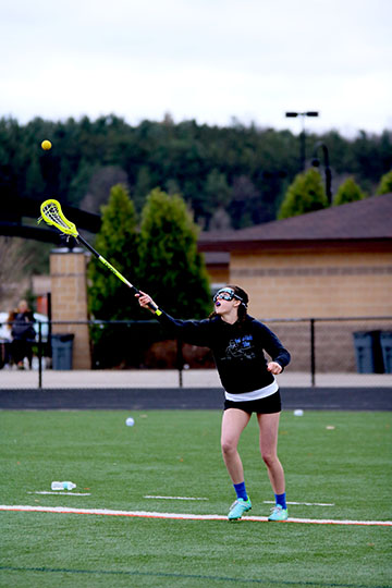 Junior Jessica Lynch, warming up before her game against Davison.  Jessica had one assist and made 17/18 draws.