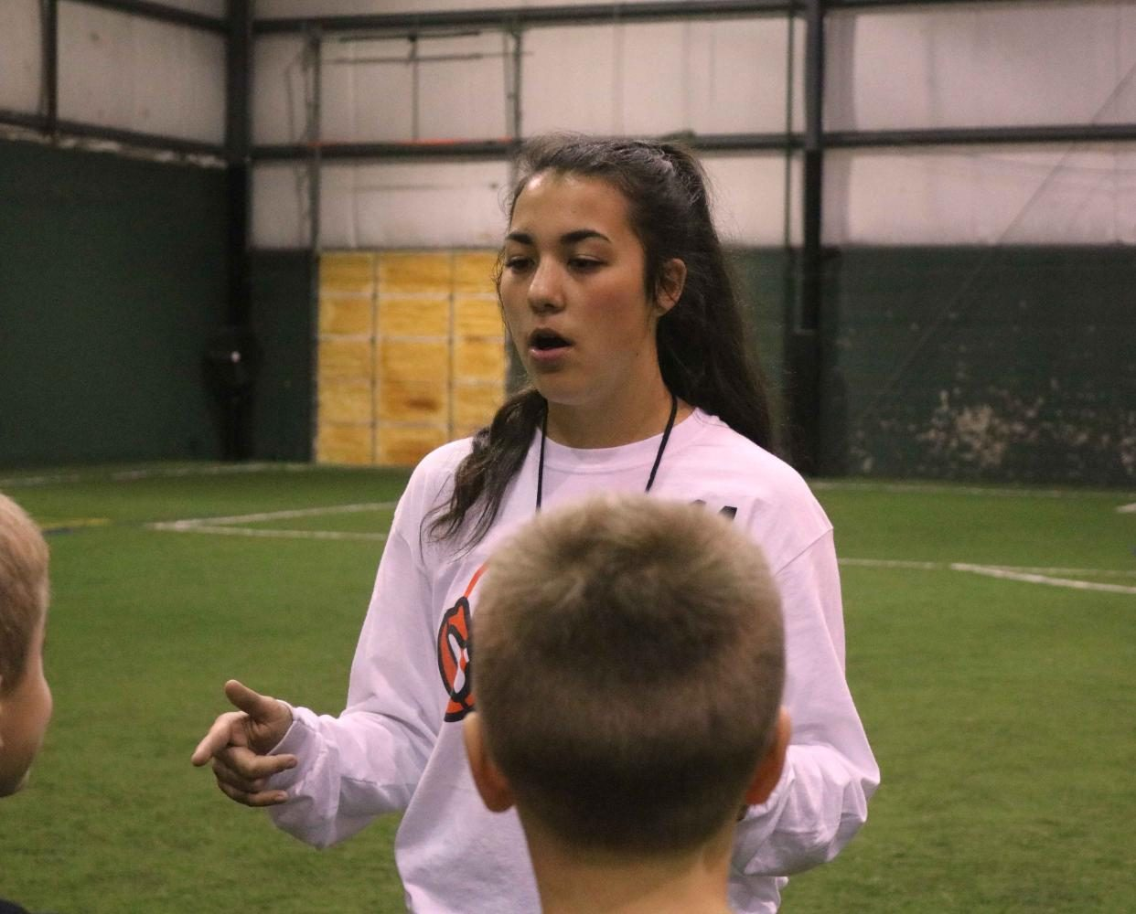 At the soccer Lock-In junior Kara Kinser, gives the kids instructions on how to safely play soccer. The Soccer Lock-In was a fundraiser to help support the girls' soccer program.
