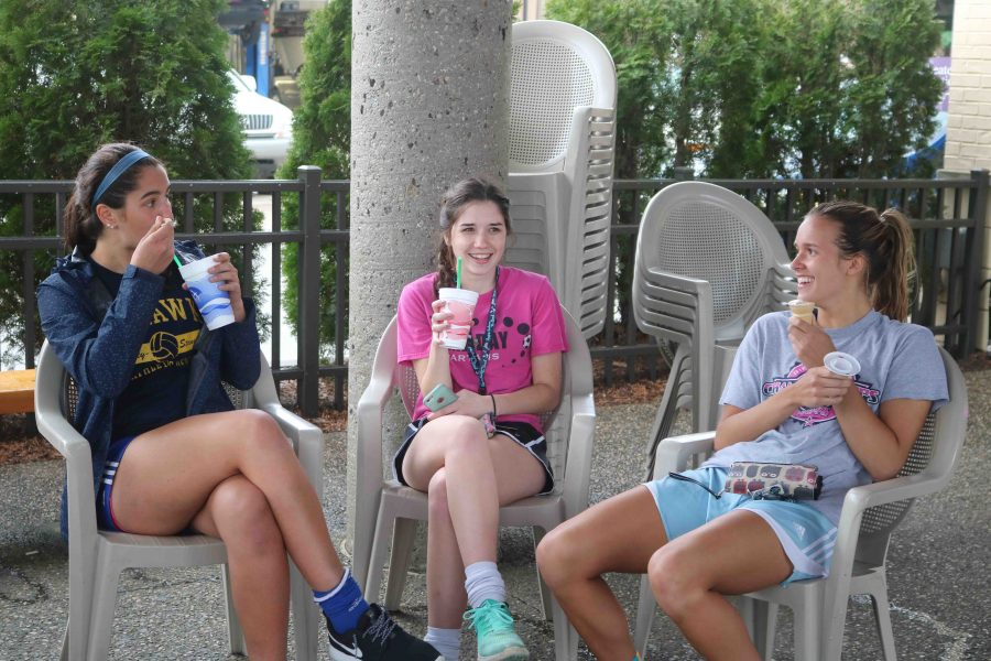 During a team bonding at Uncle Rays, senior Emma Evo and sophomores Delaney Miesch and Andrea Keoshian eat their ice cream together as they connect. The girls Varsity and Junior Varsity soccer team both went to the bonding and had a blast talking and enjoying each others company.