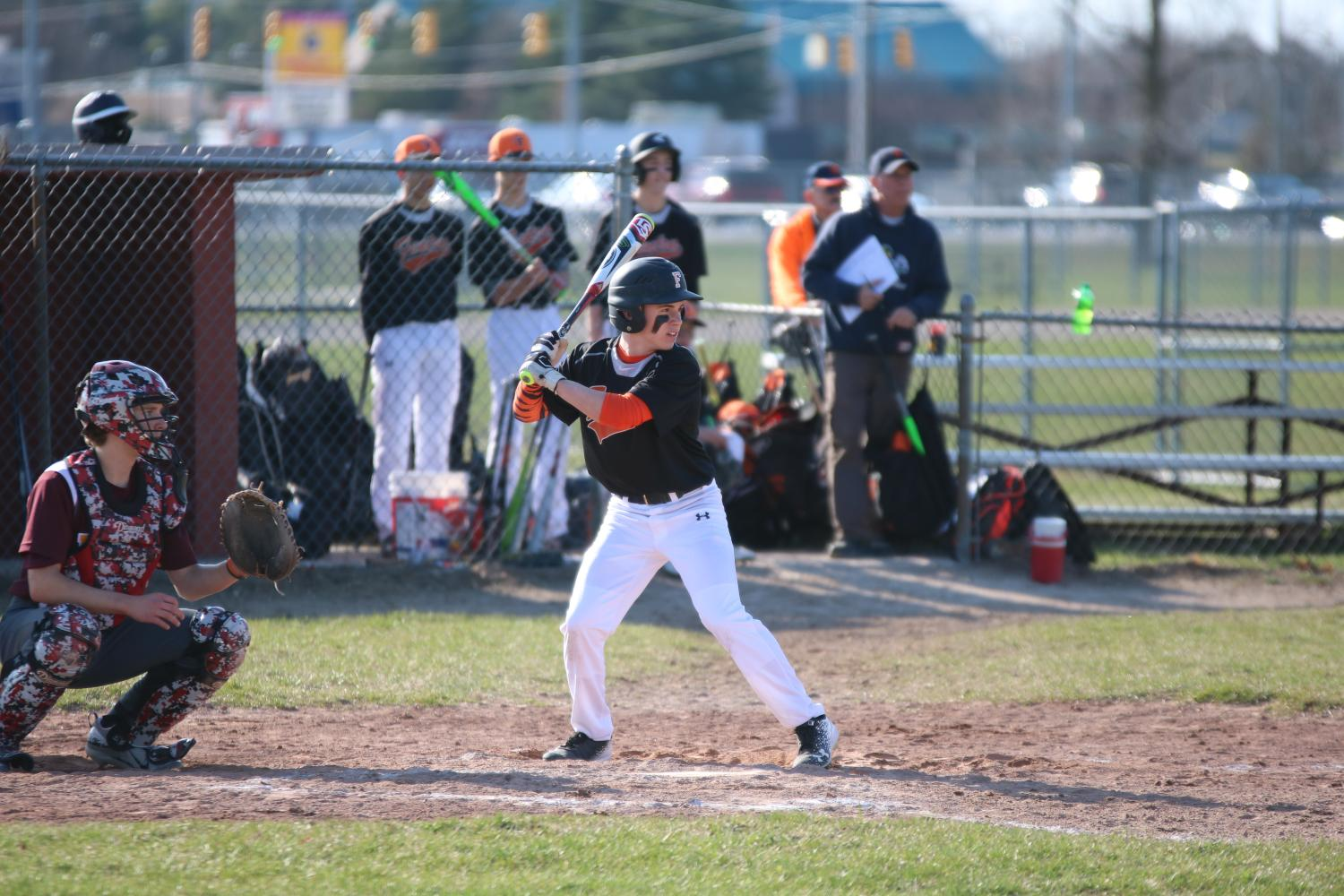 Freshman Brady Triola waits for the pitch to hit the ball.