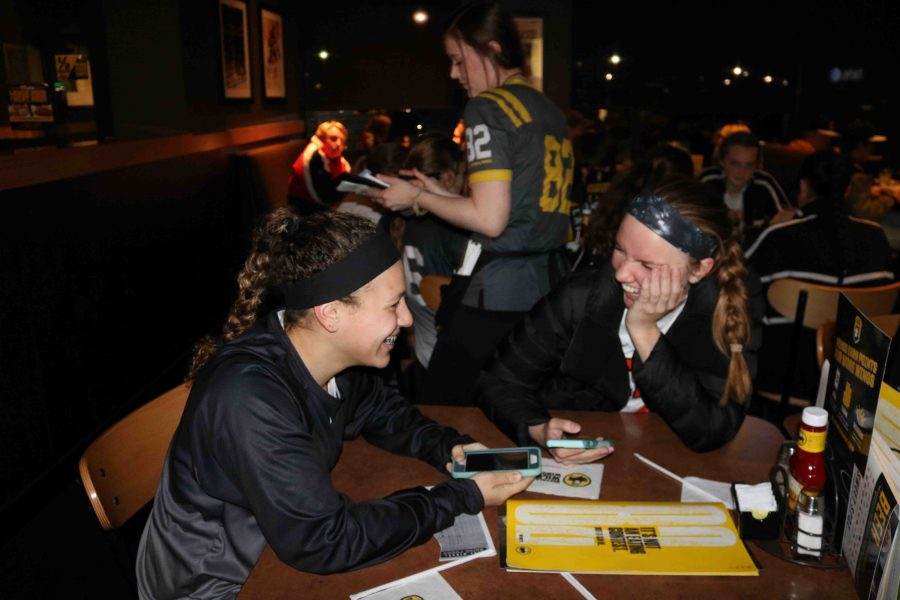During the girls soccer Buffalo Wild Wings fundraiser, senior Brittany Bush and Kirsten Foor smile about their win against Linden earlier that day. The girls  all celebrated their win and congratulated junior Sophie Crews for scoring the winning goal.