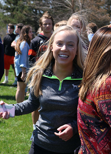 During the fire drill junior, Audrey Strickhouser laughs with her friends as they pass the time.