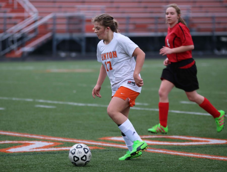 During a jv girls soccer game on March 29, freshman Meg Wolosonowich runs the ball down the field to to score a goal. The girls went up against Linden, they ended the game with a tie.