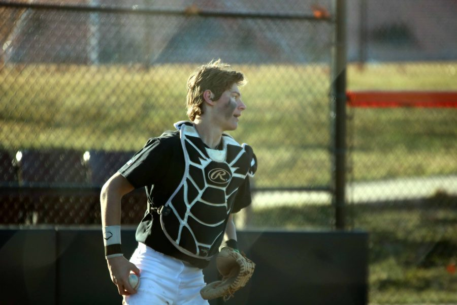 At the JV baseball team's first home game, sophomore Cameron Steeves prepares to throw the ball to his teammate.