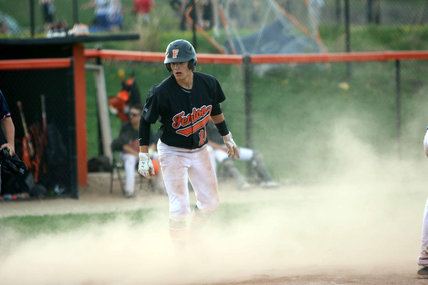 During their game against Lake Fenton on Wednesday, sophomore Logan Welch slides into home base.
