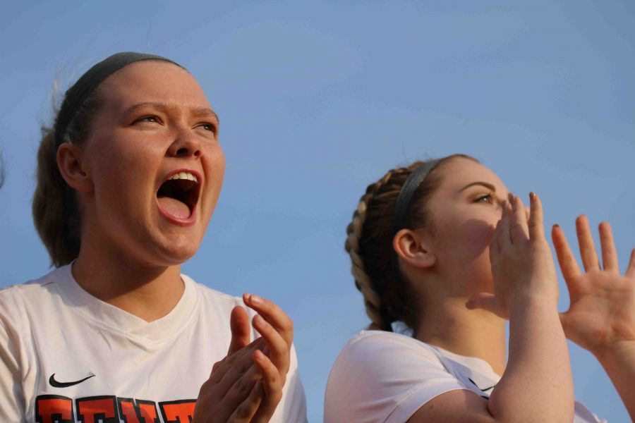 During the girls varsity soccer game, seniors Katelyn Britton and Taylor Moore cheer on their teammates. The Brandon Verses Fenton soccer game kicked off the girls Metro season.