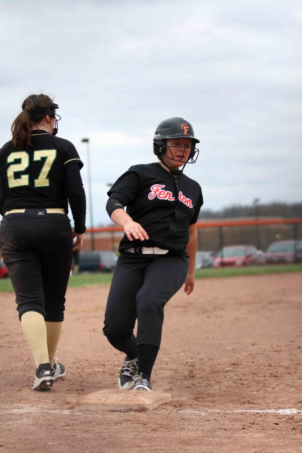 Running into third base, senior Michaela Willett is about to score for her team. The team lost to Howell during their home game on April 11.