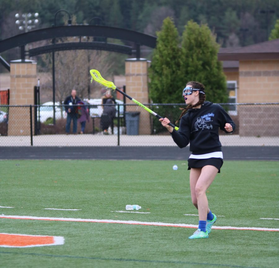 Junior Jessica Lynch runs to catch the  ball in her lacrosse helping her team in the game against Davidson.