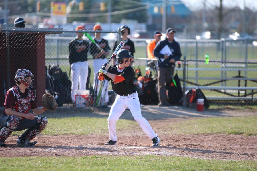 Focusing hard and positioning himself, freshman Brady Triola prepares to bat and help his team against Davidson. freshman baseball fell to Davidson 4-3.