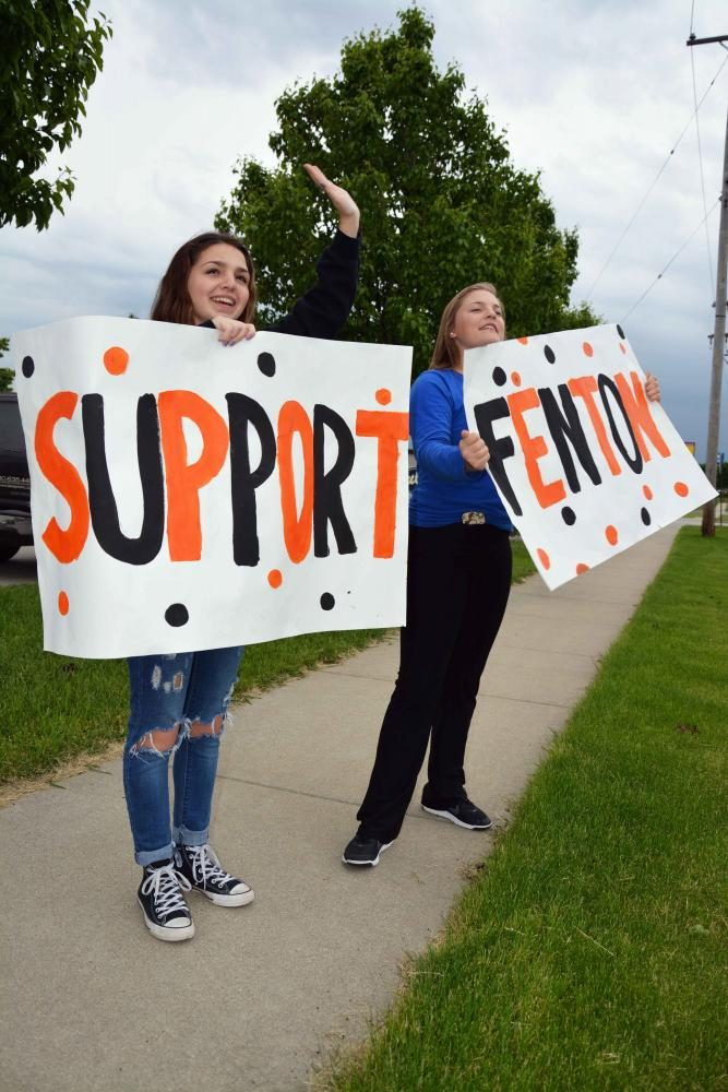 Volunteering at the Culvers fundraiser, freshman Ellie Vasbinder and Kaitlin Gruber hold signs out by Owen road in hopes of drawing in customers. The Fenton Publications staff put on a fundraiser Tuesday night in order to raise money for future conferences and summer camps.