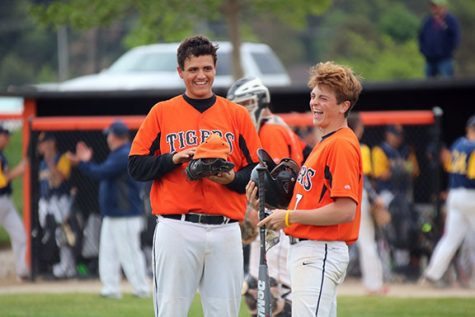 During the Heartland game, junior, Matt Sullivan and senior, Troy Smigielski pass the time by making each other laugh. Even though the tigers lost they made the best of the situation and the time they had together before Smigielski furthers his baseball career at Albion college.