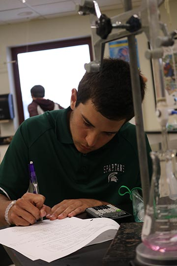 Senior Aj Randazzo competes in the chemistry portion of the annual Math and Science competition at Holly High school. Fenton competed with seven other schools in the metro.