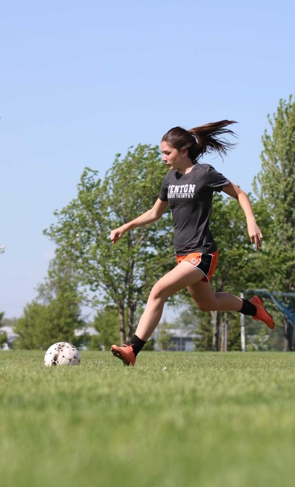 During a jv soccer practice, freshman Andrea Keoshian prepares to kick the ball into the goal. The girls were playing a soccer activity during their practice.