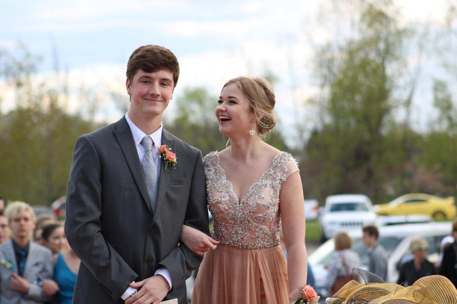 Senior+Rose+Menzies+accompanies+her+date+into+prom.+The+%22paparazzi%22+took+photos+of+the+couples+as+they+walked+on+the+red+carpet+and+into+the+dance.