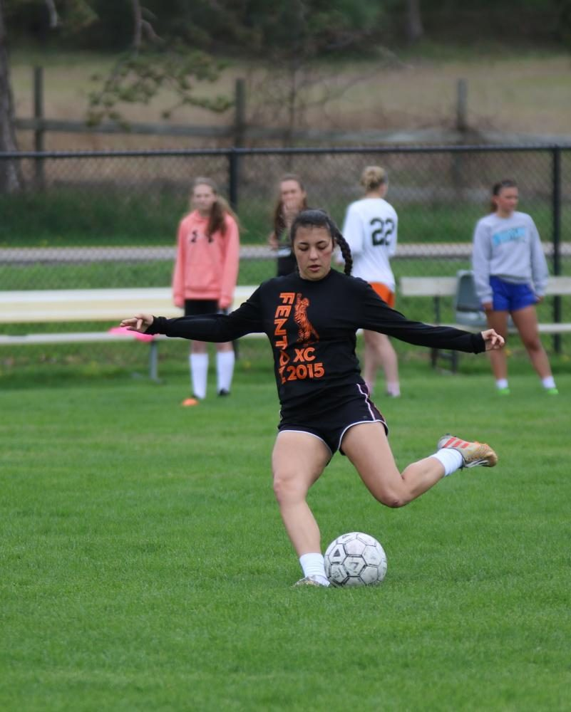 During their practice, junior Kara Kinser prepares to kick the soccer ball to score. Both the JV and Varsity teams enjoyed slushies at Speedway after their practice.