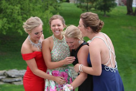 Seniors Lauren Gruber, Kelsey Kussro, Maddie Welch, and Meaghan McArdle taking pictures before there last prom.