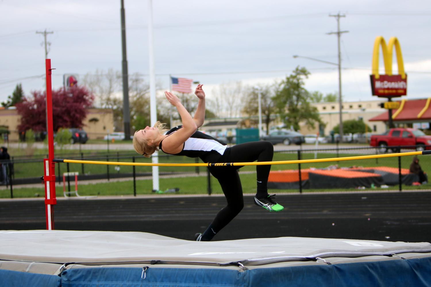 During her field event, sophomore Chloe Idoni jumps over the bar during high jump.
