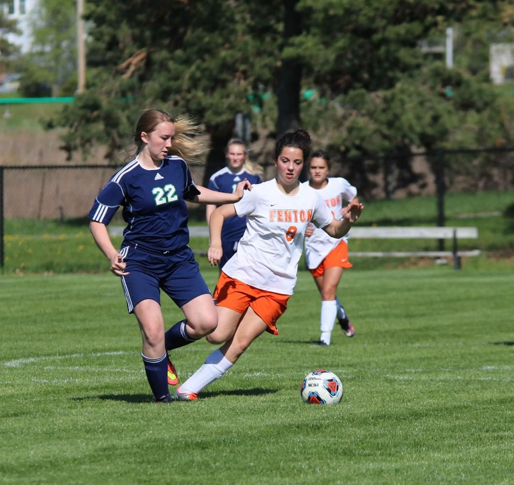 As sophomore Kenzie Cassar fights to get the soccer ball from Saginaw High, she manages to run her very hardest and steal the ball. Cassar started the game off right by making their very first goal.