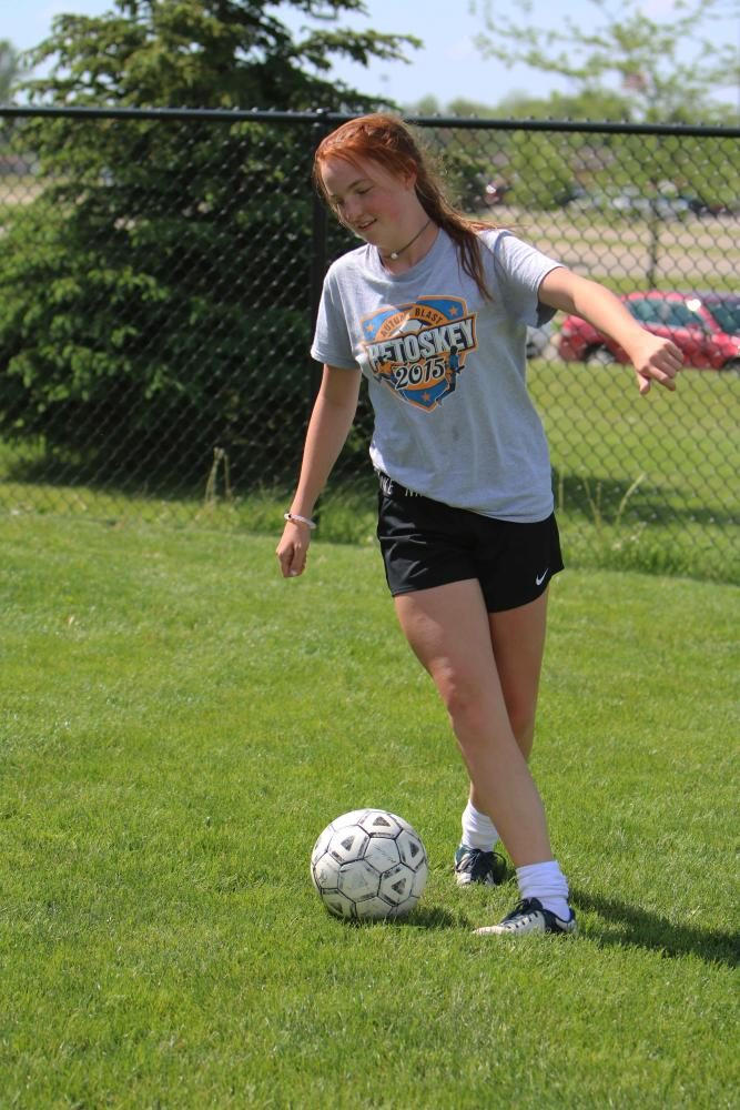 Freshman Julia Adams, passes the soccer ball to one of her teammate. Adams was preparing for their upcoming game against Linden High.