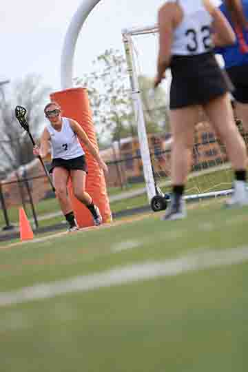 Girls Lacrosse team captain Skylar Parks playing at her game against Holly. The team won 19-5.