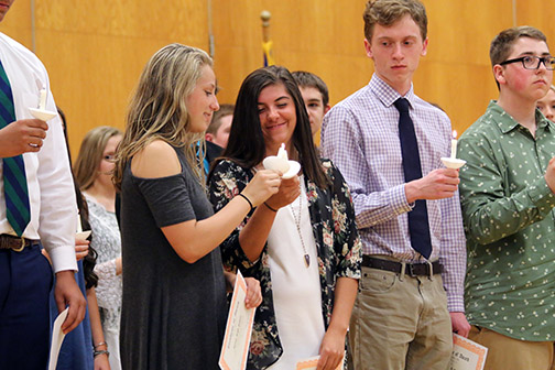 Sophomore Rachel Smith and Emma Snedden light their candles and become inducted into the National Honors Society.
